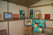 Debbie showing off some of her paintings in the Beach Hut Studio